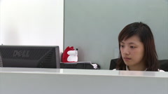 Chinese girl working in office, China Stock Footage