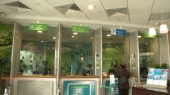 Chinese bank, customer at bank window, China Stock Footage