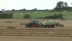 Stock Video Footage of Two balers at work on wheat straw.