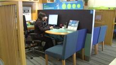 Chinese bank clerk on phone, Nanjing, China Stock Footage