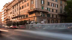 Panning time-lapse of busy traffic on a street corner in Rome, Italy. Stock Footage