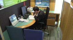 Chinese man bank clerk working, China Stock Footage