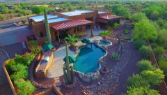 Back pan over pool Superstition mountain home AZ.mp4 Stock Footage