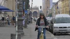 Riding bikes on Ludwigstrasse, Munich Stock Footage