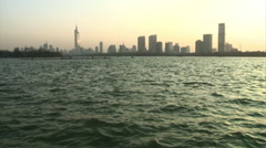 Xuanwu Lake and Nanjing skyline, China Stock Footage