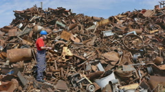 Recycling industry, worker and heap of metal Stock Footage