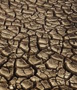 Background of dry cracked soil dirt or earth during drought Kuvituskuvat