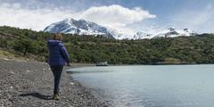 Woman standing at shoreline of Lake Argentino Stock Photos