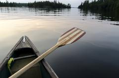 Oar on the side of a canoe on the lake, Lake of the Woods, Ontario, Canada - stock photo