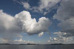 View of clouds over a lake, Lake of the Woods, Ontario, Canada - stock photo