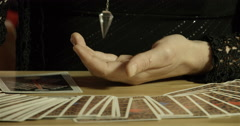 Female Hands Tarot and Swinging Crystal 4K Stock Footage