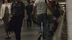 subway station corridor underground with people walking in 4K in NYC - stock footage