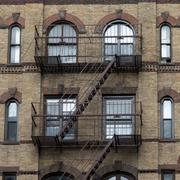 Exterior view of a building fire escape staircase in Midtown - stock photo