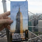 Hand holding a photograph of the Empire State Building Stock Photos