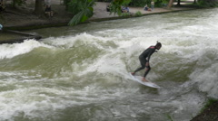 Man surfing on Isar River in Munich Stock Footage