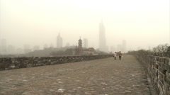 Ming city walls, pagoda & skyscrapers, China Stock Footage