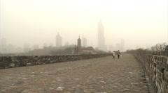 Ming city walls, pagoda & skyscrapers, China - stock footage