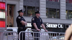 Police officers in Times Square behind barriers in 4K in NYC Stock Footage