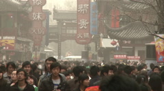 Chinese crowds, city shopping street, China - stock footage