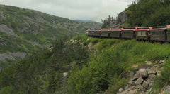 Rail Cars Traversing Mountainous Country Side - stock footage