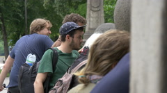 People gathered at Eisbachwelle, Munich Stock Footage