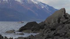 Small Fishing Boat Near Rocky Shore Line in Alaska Stock Footage