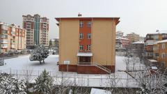 School building under snow. Winter view Stock Footage