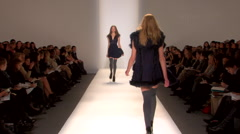 Fashion models walking on runway for Cynthia Steefe Collection Stock Footage