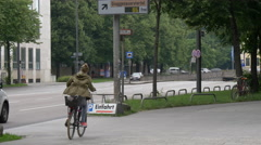 Driving cars and riding bikes on Prinzregentenstrasse, Munich Stock Footage