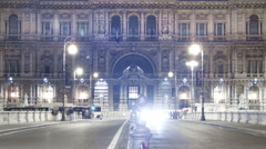 Panning time-lapse of shot of the Palace of Justice from the bridge at night. Stock Footage