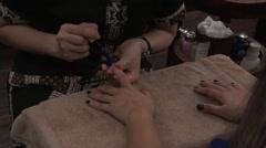 Blue nail polish application Stock Footage