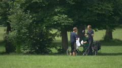 Two men boxing in the English Garden, Munich Stock Footage
