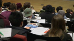 Students in lecture theatre Stock Footage