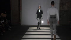 Fashion models walking on runway for David Elfin Collection Stock Footage
