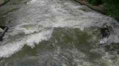 River surfing and turning around on the Isar River, Munich - stock footage