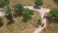 Stock Video Footage of Сycliststracking in mountain terrain for the tourist site or travel agency