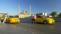 Taxi passengers and street traffic at Eminonu Square Stock Footage