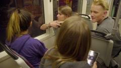 Teens using iPad on max train Stock Footage
