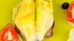 Served roast golden fish fillet over wood Stock Footage