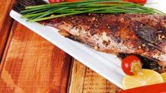 Savory on wood: fryed sunfish Stock Footage