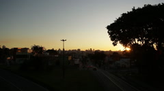 Stock Video Footage of Timelapse view of the sunset with the big city on the background in Curitiba,