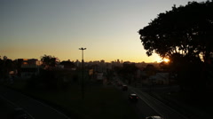 Stock Video Footage of Big view of the sunset with the big city on the background in Curitiba, Brazil