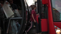 People getting of and boarding a public bus in Curitiba, Brasil. The city is Stock Footage