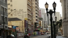 Stock Video Footage of The ugly center of a big city in Brazil, Curitiba. Defaced walls.
