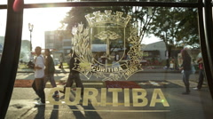 The logo of the city of Curitiba, Brasil on a bus station (estacao tubo). The Stock Footage