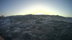First person view of the ocean looking to the city on the shore - stock footage