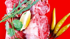 Uncooked meat medallion on red Stock Footage