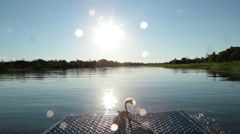 Riding a Speedboat On The Amazon River in front of a beautiful great blue sky wi Stock Footage