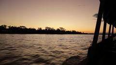 Riding a Speedboat On The Amazon River in front of a beautiful sunset, South Stock Footage