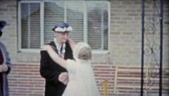 1953: Girl celebrating her first catholic communion kissing grandma. - stock footage